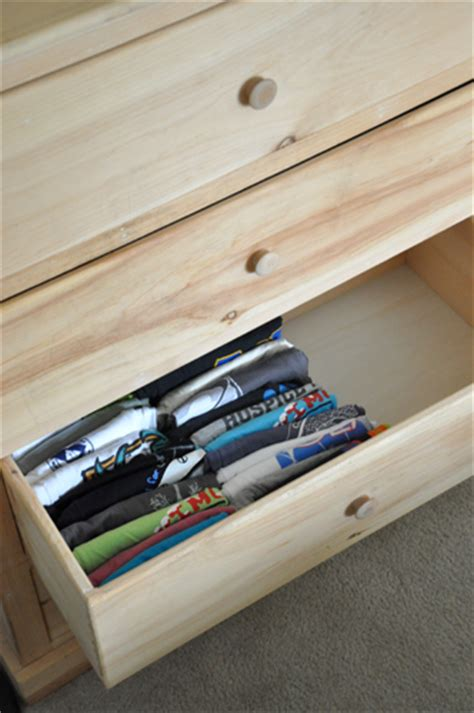 How To Organize T Shirts In A Drawer by Organized T Shirt Drawers Alldaychic