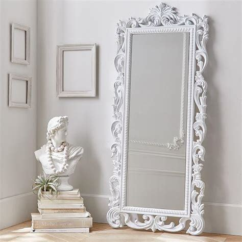 white ornate wood carved floor mirror