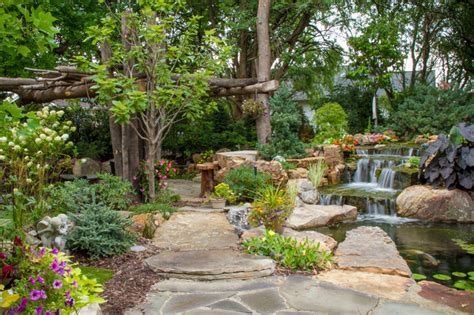 tree and waterfall inspired backyard traditional