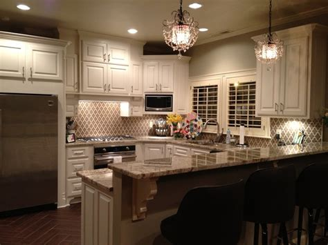 white cabinets typhoon bordeaux granite countertops