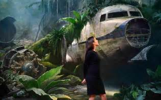 Christie s employee poses for a photograph with jungle scene