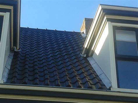 schuur zonder vergunning glimmende zwarte dakpannen mag dit vergunningvrij