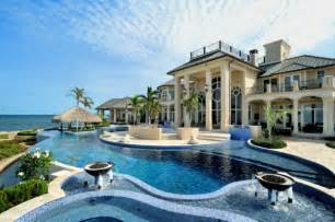 16 exotic tropical swimming pool designs for the ultimate new pool and pool house complete with waterfall spa and