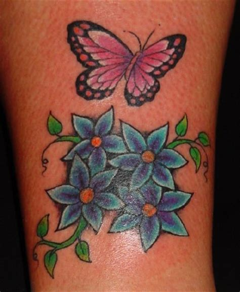 Butterfly And Flower Tattoos Make A Unique Tattoo Design Butterfly Flower And Tattoos