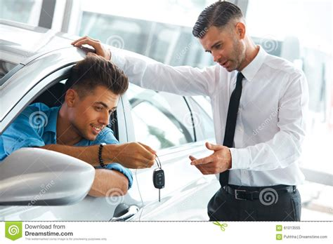 car sales consultant showing   car   potential