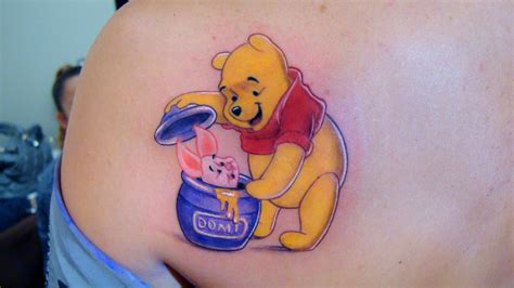 an incredible tattoo of winnie the pooh discovering piglet