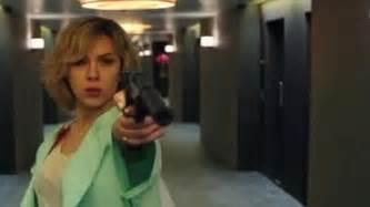 lucy film guns scarlett johansson covers burgeoning baby bump in floaty