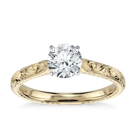 engraved solitaire engagement ring in 18k yellow gold