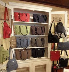 Handbag Storage Cabinet by Bag Shop On Bag Store Display Bag Storage And