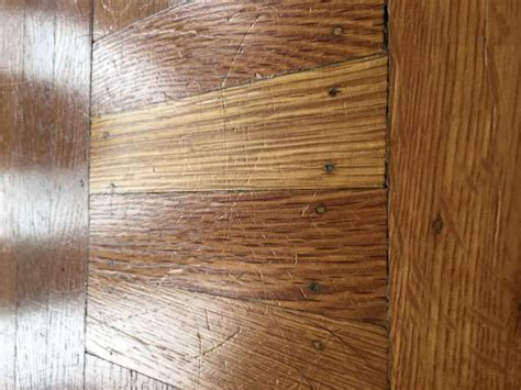 Scratches from my big dog on hardwood floor, what should I