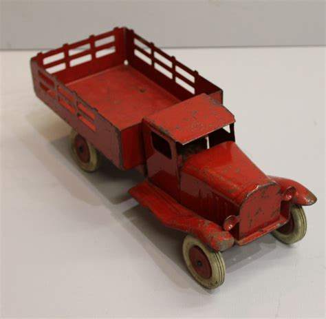 Bargain John's Antiques   Pressed Metal Stake bed red