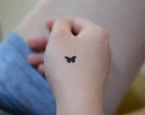 small black butterfly tattoo 33 small butterfly designs ideas 2018