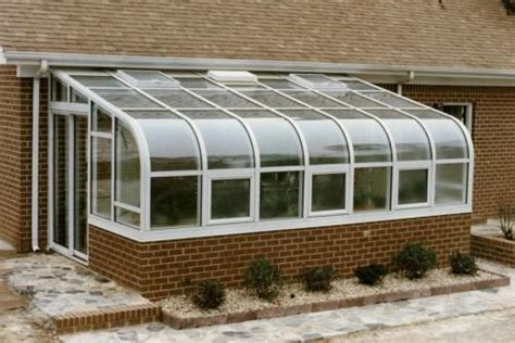residential curved eave solarium home landscaping