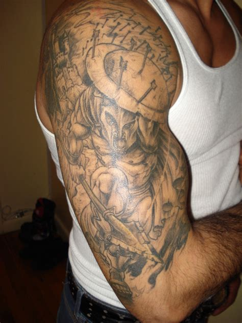 spartan quarter sleeve tattoo added a lot more to nick s lower leg tattoo the t rock and