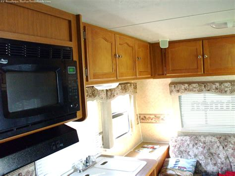Rv Kitchen Cabinets 5 Rv Storage Solutions How To Make The Most Of Limited Storage Space Times Guide To Rving