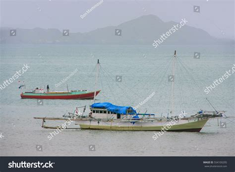 traditional outrigger boat anchored labuan bajo stock