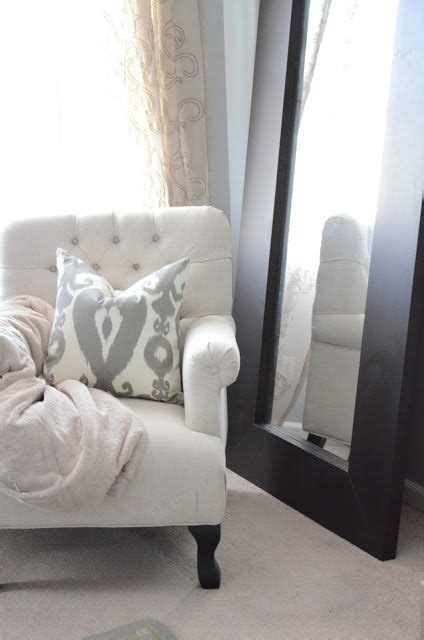 gray and white reading chair reading nook gray bedroom leaning mirror the