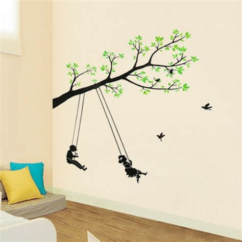 painting of boy and girl on swing boy and girl swinging under the green tree vinyl wall