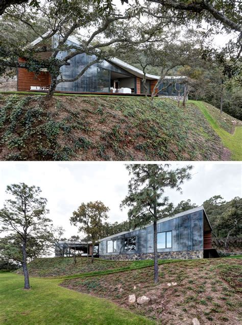 a butterfly roof contains this house on a hillside in