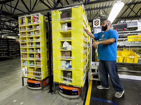 amazon warehouse robots citvoice meet the robot armies that are transforming