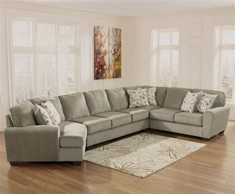 sectional couch with cuddler ashley furniture patola park patina 4 piece sectional
