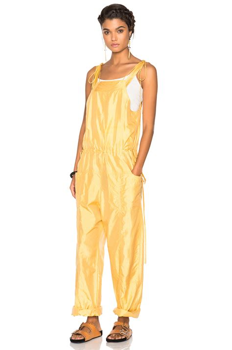claire danes yellow jumpsuit claire danes is radiant in vibrant yellow jumpsuit on new