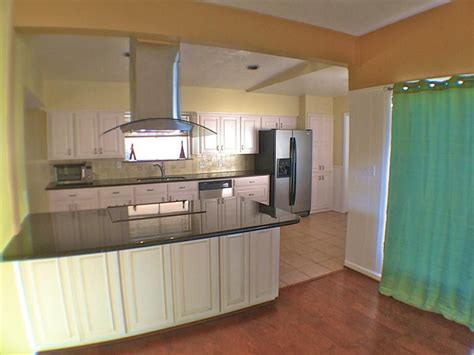 kitchen with glass cooktop in the island and new