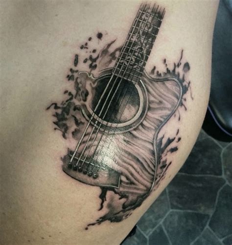 small guitar tattoo designs tricky guitar shoulder ideas