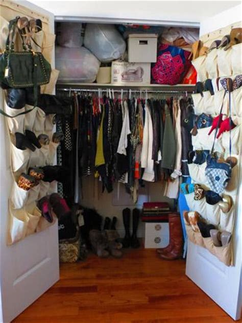 Arranging Clothes In Wardrobe by
