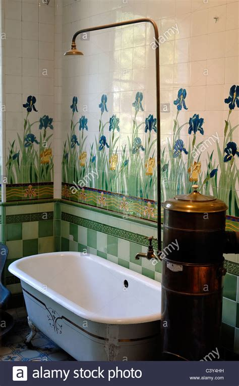 bathroom water heater old bath tiled bathroom with old solid fuel copper hot water heater stock photo