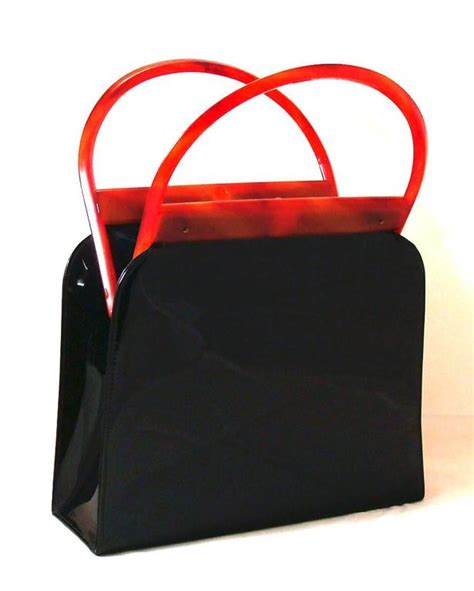 8 Bold Bags by Bold And Chic Black Patent Bag With Lucite Frame And