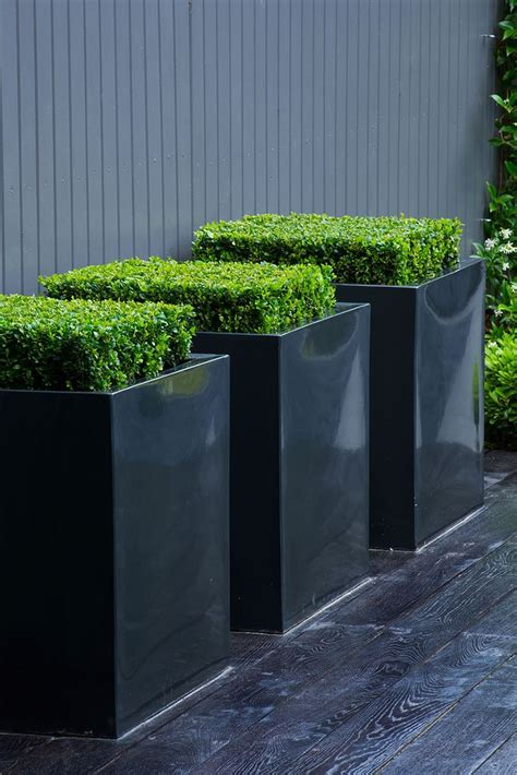 Powder Coated Planters by 20 Metal Planters Design And Sculpture By Adam Christopher