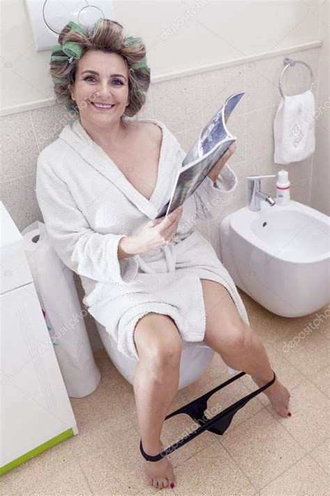 Sitting On The by Beautiful Sitting On The Toilet Reading A Magazine
