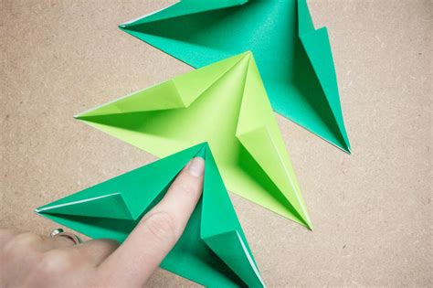 christmas tree paper folding make an easy origami tree garland hgtv