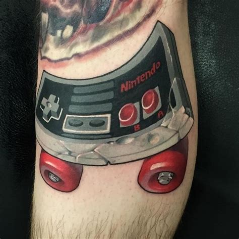 nintendo controller tattoo inked wednesday 88 nintendo sandman and more nerdist