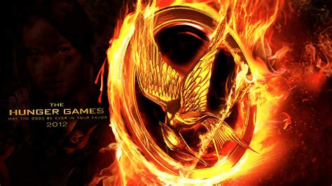 the hunger games movie poster wallpapers the hunger games wallpaper 24129229 fanpop