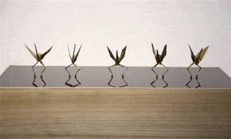 Origami Crane With Legs - paper cranes sprout legs and boogie in this