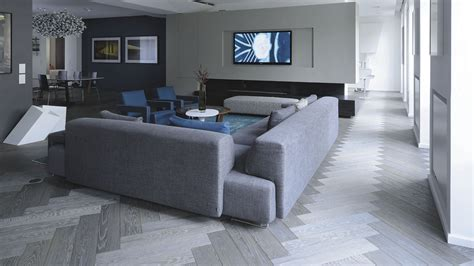 grey wooden floor l storm inspired grey and blue living room herringbone