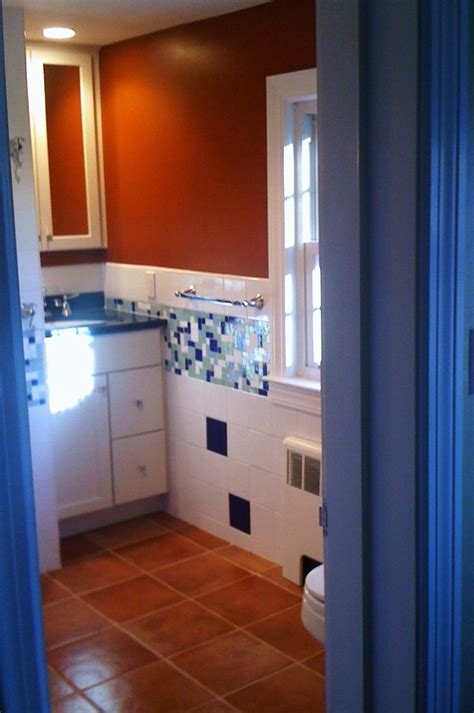rust colored bathroom spanish themed bathroom with blue white and rust as the