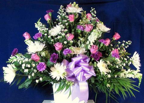 send sympathy funeral flowers in wellington fl blossom custom sympathy basket featuring lavender roses snapdragons larkspur and spider mums