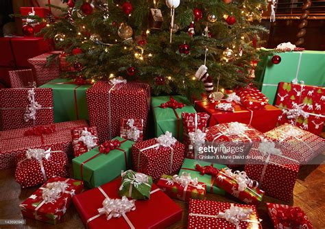 images of christmas gifts under the tree christmas gifts under tree stock photo getty images