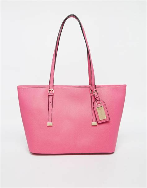pink hatchet aldo hatchet mini tote with buckle detail in pink lyst