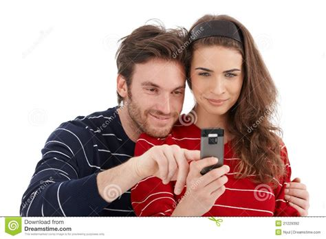 For Couples On Phone Happy Using Mobile Phone Smiling Stock Photography