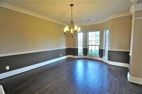formal dining room with upgrade two tone interior paint crown molding chair railing