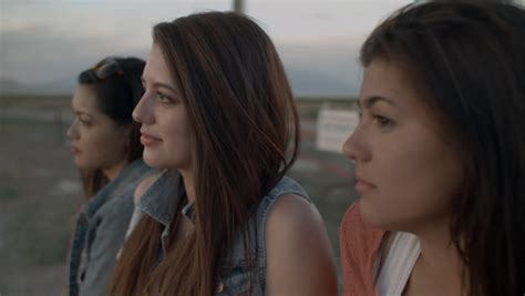 beautiful teen getting beautiful teen girl gets out of a convertible at dusk and
