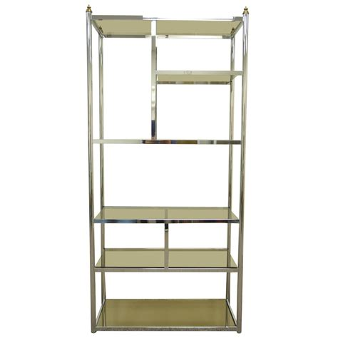 chrome and glass bookcase hollywood regency directoire style chrome brass and