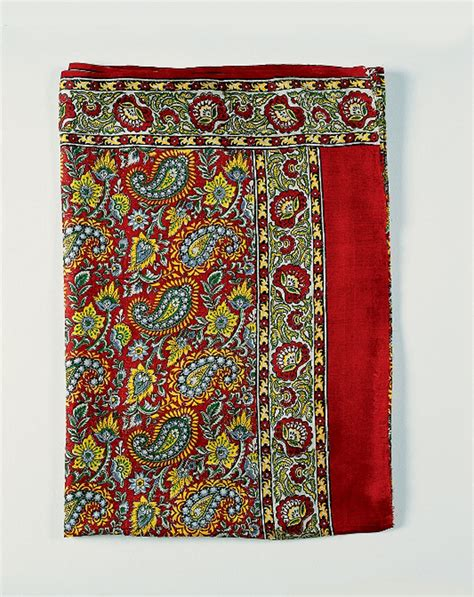boteh pattern history file folded red sari with white and yellow boteh pattern