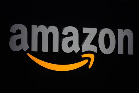 amazon mp3 uk to launch service to compete with apple and spotify