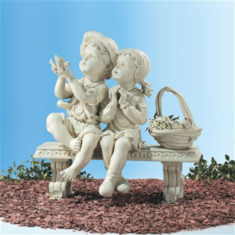 little girl sitting on bench statue garden sculptures and statures