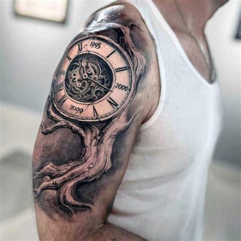 tatuaje en el brazo 225 rbol torcido seco con reloj grande